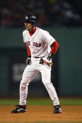 BOSTON - OCTOBER 4:  Shortstop Nomar Garciaparra #5 of the Boston Red Sox leads off a base against the Oakland Athletics during game three of the American League Division Series at Fenway Park on October 4, 2003 in Boston, Massachusetts.  The Red Sox defe