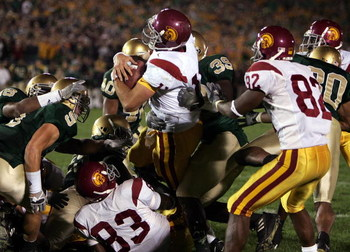 SOUTH BEND, IN - OCTOBER 15:  Quarterback Matt Leinart #11 of the University of Southern California Trojans rolls into the end zone with the winning touchdown against the Notre Dame Fighting Irish on October 15, 2005 at Notre Dame Stadium in South Bend, I