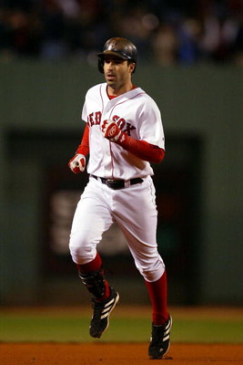 BOSTON - OCTOBER 13:  Todd Walker #12 of the Boston Red Sox rounds the bases after hitting a home run in the bottom of the fourth inning of Game 4  of the 2003 American League Championship Series against the New York Yankees October 13, 2003 at Fenway Par