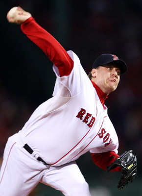 BOSTON - OCTOBER 20:  Starting pitcher Curt Schilling #38 of the Boston Red Sox deals against the Cleveland Indians during Game Six of the American League Championship Series at Fenway Park on October 20, 2007 in Boston, Massachusetts.  (Photo by Elsa/Get