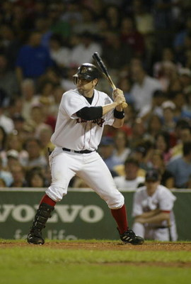 BOSTON, MA - SEPTEMBER 3:  Doug Mientkiewicz #13 of Boston Red Sox bats against the Texas Rangers on September 3, 2004 at Fenway Park in Boston, Massachusetts.(Photo by Rick Stewart/Getty Images)