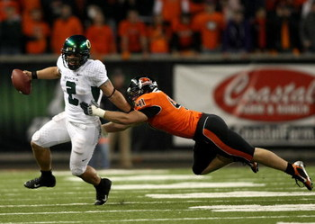 CORVALLIS, OR - NOVEMBER 29:  Quarterback Jeremiah Masoli #2  of the Oregon Ducks eludes the rush of Bryant Cornell #41 of the Oregon State Beavers at Reser Stadium on November 29, 2008 in Corvalis, Oregon.  (Photo by Jonathan Ferrey/Getty Images)