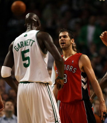 BOSTON - NOVEMBER 10:  Jose Calderon #8 of the Toronto Raptors and Kevin Garnett #5 of the Boston Celtics exchange words on November 10,  2008 at TD Banknorth Garden in Boston, Massachusetts. The Celtics defeated the Toronto Raptors 94-87.  NOTE TO USER: