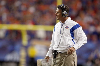 ATLANTA - DECEMBER 06:  Head coach Urban Meyer of the Florida Gators watches the action against the Alabama Crimson Tide during the SEC Championship on December 6, 2008 at the Georgia Dome in Atlanta, Georgia.  (Photo by Kevin C. Cox/Getty Images)