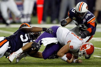 ATLANTA - DECEMBER 31:  Antonio Coleman #52 and Chris Evans #59 of the Auburn University Tigers tackle Cullen Harper #10 of the Clemson University Tigers during the Chick-Fil-A Bowl on December 31, 2007 at the Georgia Dome in Atlanta, Georgia.  (Photo by