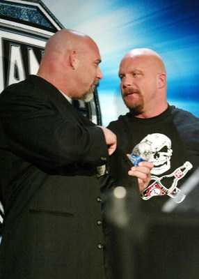 NEW YORK - MARCH 11:  (L-R) Wrestlers Goldberg and Stone Cold Steve Austin attend a press conference to promote Wrestlemania XX at Planet Hollywood March 11, 2004 in New York City.  (Photo by Peter Kramer/Getty Images)