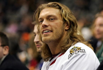 DALLAS - JANUARY 23:  WWE wrestler 'Edge' watches the 2007 NHL Youngstars Game at the American Airlines Center on January 23, 2007 in Dallas, Texas.  (Photo by Jim McIsaac/Getty Images)