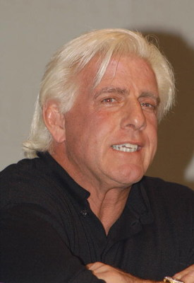 GARDEN CITY, NY - MARCH 3:  World Wrestling Entertainment (WWE) professional wrestler Ric Flair speaks on a panel during the 'Professor For A Day' event at Nassau Community College March 3, 2003 in Garden City, New York. Flair acted as an assistant profes