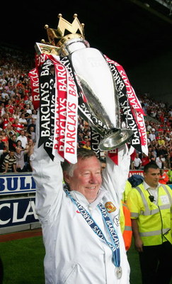 WIGAN, UNITED KINGDOM - MAY 11:  Manchester United Manager Sir Alex Ferguson holds the Barclays Premier League trophy aloft at the end of the Barclays Premier League match between Wigan Athletic and Manchester United at The JJB Stadium on May 11, 2008 in