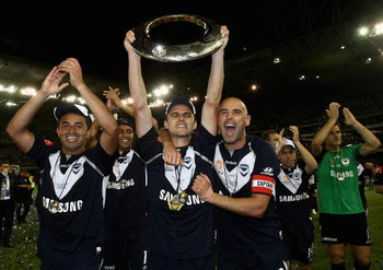 MELBOURNE, AUSTRALIA - FEBRUARY 28:  Melbourne Victory players celebrate victory in the A-League Grand Final match between the Melbourne Victory and Adelaide United at the Telstra Dome on February 28, 2009 in Melbourne, Australia.  (Photo by Quinn Rooney/