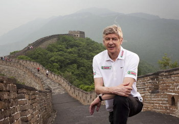 BEIJING, CHINA - JUNE 7:  Arsenal Manager Arsene Wenger poses for a portrait on a visit to the Great Wall of China during his tour of Asia with FIFA World Cup sponsor Castrol, on June 7, 2008 in Beijing, China.  (Photo by Adam Pretty/Getty Images for Cast