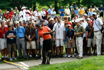 BETHESDA, MD - JULY 02:  Tiger Woods hits from the gallery on his third shot of the 16th hole during the first round of the AT&T National at the Congressional Country Club on July 2, 2009 in Bethesda, Maryland.  (Photo by Win McNamee/Getty Images)