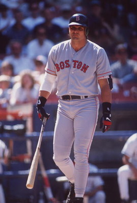 26 May 1996:  Designated hitter Jose Canseco of the Boston Red Sox is visibly frustrated as he walks back to the dug out following an unsuccessful at-bat in the Red Sox 12-2 loss to the California Angeles at Anaheim Stadium in Anaheim, California.   Manda