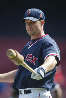 BOSTON - APRIL 14:  Third baseman Shea Hillenbrand #29 of the Boston Red Sox takes a warm up swing before the MLB game against the New York Yankees at Fenway Park in Boston, Massachusetts on April 14, 2002. The Yankees won 6-2. (Photo by Al Bello/Getty Im