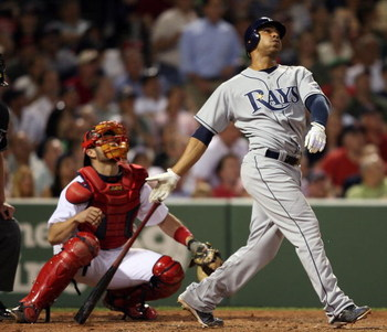 BOSTON - JUNE 03:  Carlos Pena #23 of the Tampa Bay Rays hits a two run homer in the sixth inning as Jason Varitek #33 of the Boston Red Sox catches on June 3, 2008 at Fenway Park in Boston, Massachusetts.  (Photo by Elsa/Getty Images)