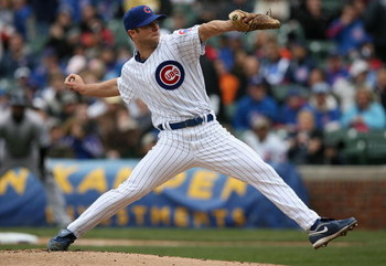 CHICAGO - APRIL 15: Starting pitcher Rich Harden of the Chicago Cubs, wearing a #42 jersey during the Jackie Robinson Day game, delivers the ball against the Colorado Rockies on April 15, 2009 at Wrigley Field in Chicago, Illinois. (Photo by Jonathan Dani