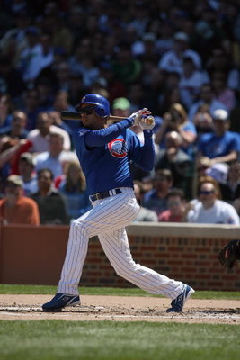 CHICAGO - APRIL 17:  Aramis Ramirez #16 of the Chicago Cubs bats against the St. Louis Cardinals on April 17, 2009 at Wrigley Field in Chicago, Illinois. (Photo by Jonathan Daniel/Getty Images)