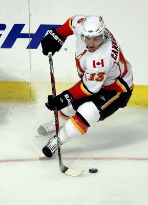 CHICAGO - APRIL 16:  Michael Cammalleri #13 of the Calgary Flames skates with the puck against the Chicago Blackhawks during Game One of the Western Conference Quarterfinals of the 2009 Stanley Cup Playoffs on April 16, 2009 at the United Center in Chicag