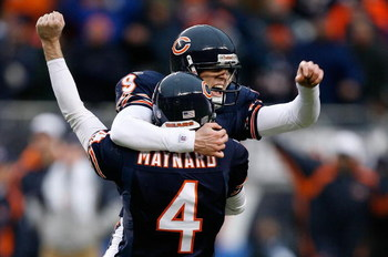 CHICAGO - JANUARY 14:  Kicker Robbie Gould #9 of the Chicago Bears celebrates his game-winning 49-yard field goal with Brad Maynard #4 in overtime against the Seattle Seahawks during their NFC Divisional Playoff Game January 14, 2007 at Soldier Field in C