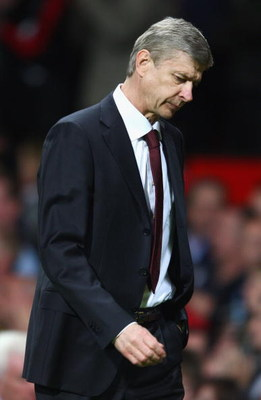 MANCHESTER, ENGLAND - APRIL 29:  Arsenal Manager Arsene Wenger walks off at the end of the UEFA Champions League Semi Final First Leg match between Manchester United and Arsenal at Old Trafford on April 29, 2009 in Manchester, England.  (Photo by Clive Br