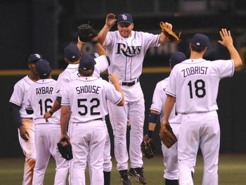 ST. PETERSBURG, FL - APRIL 13: Players of the Tampa Bay Rays celebrate a home-opening win against the New York Yankees April 13, 2009 in St. Petersburg, Florida.  (Photo by Al Messerschmidt/Getty Images)