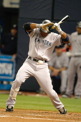 MINNEAPOLIS, MN - JULY 9:  Robinson Cano #24  of the New York Yankees avoids an inside pitch during action against the Minnesota Twins at Hubert H. Humphrey Metrodome on July 9, 2008 in Minneapolis, Minnesota. The Yankees defeated the Twins 6-4. (Photo by