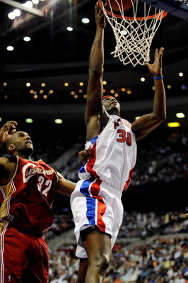 AUBURN HILLS, MI - APRIL 24:  Kwame Brown #38 of the Detroit Pistons goes to the basket past Joe Smith #32 of the Cleveland Cavaliers in Game Three of the Eastern Conference Quarterfinals during the 2009 NBA Playoffs at the Palace of Auburn Hills on April