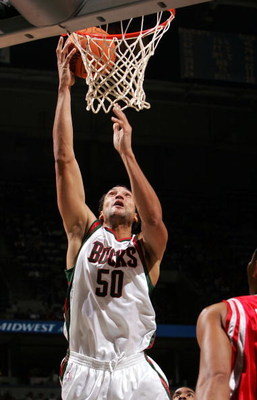 MILWAUKEE - NOVEMBER 08:  Dan Gadzuric #50 of the Milwaukee Bucks dunks the ball against the Houston Rockets on November 8, 2006 at the Bradley Center in Milwaukee, Wisconsin. The Rockets defeated the Bucks 97-93.  NOTE TO USER: User expressly acknowledge