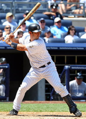 NEW YORK - JULY 06:  Jorge Posada #20 of the New York Yankees bats against the Toronto Blue Jays on July 6, 2009 at Yankee Stadium in the Bronx borough of New York City. The Jays defeated the yankees 7-6.  (Photo by Jim McIsaac/Getty Images)