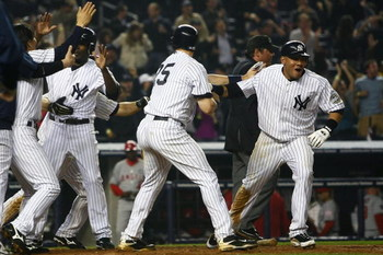 NEW YORK - MAY 01: Melky Cabrera #53 and Mark Teixeira #25 of the New York Yankees celebrate at home plate after teammate Jorge Posada #20 hit a two run single to win the game in the 9th inning against the Los Angeles Angels of Anaheim during their game o