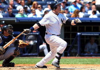 NEW YORK - JULY 06:  Eric Hinske #14 of the New York Yankees bats against the Toronto Blue Jays on July 6, 2009 at Yankee Stadium in the Bronx borough of New York City.  (Photo by Jim McIsaac/Getty Images)