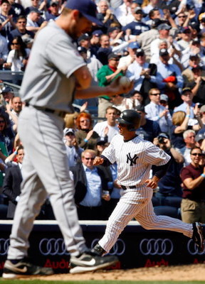 NEW YORK - APRIL 16:  Jorge Posada #20 of the New York Yankees runs the bases after hitting a fifth inning home run against Cliff Lee #31 of the Cleveland Indians on April 16, 2009 at Yankee Stadium in the Bronx borough of New York City. It was the first