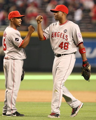 PHOENIX - JUNE 27:  Chone Figgins #9 and Torii Hunter #48 of the Los Angeles Angels of Anaheim celebrate after defeating the Arizona Diamondbacks during the major league baseball game at Chase Field on June 27, 2009 in Phoenix, Arizona. The Angels defeate
