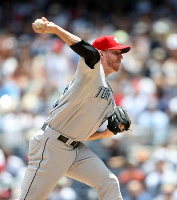 NEW YORK - JULY 04:  Roy Halladay #32 of the Toronto Blue Jays pitches against the New York Yankees on July 4, 2009 at Yankee Stadium in the Bronx borough of New York City.  (Photo by Nick Laham/Getty Images)