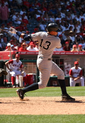 ANAHEIM, CA - JULY 12:  Alex Rodriguez #13 of the New York Yankees fouls off a pitch for strike two as he strikes out for the last out of the game against the Los Angeles Angels of Anaheim on July 12, 2009 at Angel Stadium in Anaheim, California.  The Ang