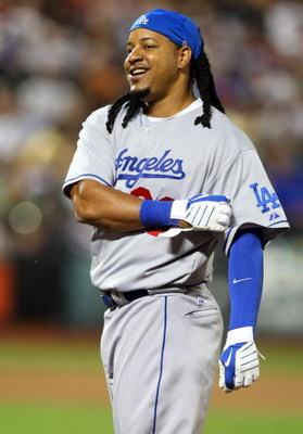 NEW YORK - JULY 08:  Manny Ramirez #99 of the Los Angeles Dodgers looks on after grounding out to end the sixth inning against the New York Mets on July 8, 2009 at Citi Field in the Flushing neighborhood of the Queens borough of New York City.  (Photo by