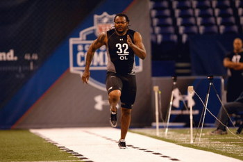 INDIANAPOLIS, IN - FEBRUARY 21:  Offensive lineman Phil Loadholt of Oklahoma runs the 40 yard dash during the NFL Scouting Combine presented by Under Armour at Lucas Oil Stadium on February 21, 2009 in Indianapolis, Indiana. (Photo by Scott Boehm/Getty Im
