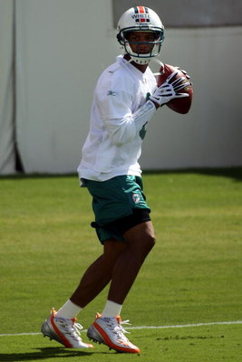 DAVIE, FL - MAY 02:  Rookie quarterback Pat White  #6 of the Miami Dolphins drops back to pass during mini camp on May 2, 2009 at the Miami Dolphins Training facility in Davie, Florida.  (Photo by Marc Serota/Getty Images)