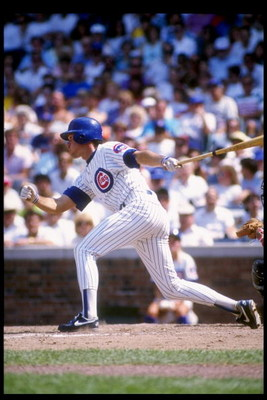 Second baseman Ryne Sandberg of the Chicago Cubs swings at the ball during a game at Wrigley Field in Chicago, Illinois.