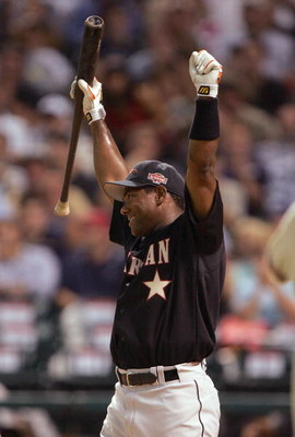 HOUSTON - JULY 12:  Miguel Tejada of the American Team celebrates after winning the Major League Baseball Century 21 Home Run Derby at Minute Maid Park on July 12, 2004 in Houston, Texas. (Photo by Jed Jacobsohn/Getty Images)