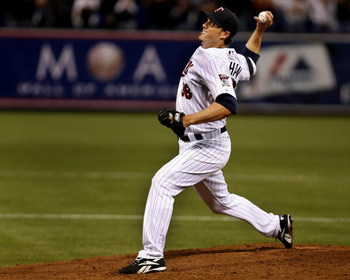 MINNEAPOLIS, MN - APRIL 2: Joe Nathan #36 of the Minnesota Twins pitches the ninth inning, earning a save for the Minnesota Twins in their home opener against the Baltimore Orioles on April 2, 2007 at the Metrodome in Minneapolis, Minnesota. (Photo by Sco