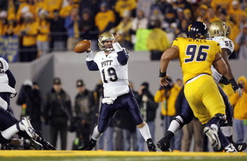 MORGANTOWN, WV - DECEMBER 1: Pat Bostick #19 of the Pittsburgh Panthers passes during the game against the West Virginia Mountaineers at Milan Puskar Stadium on December 1, 2007 in Morgantown, West Virginia. Pittsburgh defeated West Virginia 13-9. (Photo 