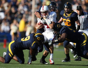BERKELEY, CA - NOVEMBER 22: Tavita Pritchard #14 of the Stanford Cardinal is sacked by Eddie Young #9 of the California Golden Bears during an NCAA football game on November 22, 2008 at Memorial Stadium in Berkeley, California.  (Photo by Jed Jacobsohn/Ge