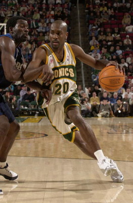 12 Feb 2002:  Gary Payton #20 of the Seattle Supersonics drives against Michael Finley #4 of the Dallas Mavericks at Key Arena in Seattle, Washington. The Mavericks defeated the Sonics 112-106. Digital Image. NOTE TO USER:  User expressly acknowledges and