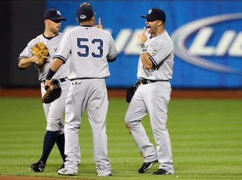 NEW YORK - JUNE 27:  Nick Swisher #33, Melky Cabrera #53, and Brett Gardner #11 of the New York Yankees celebrate after defeating the New York Mets on June 27, 2009 at Citi Field in the Flushing neighborhood of the Queens borough of New York City.  (Photo