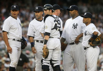 NEW YORK - JULY 2: (L-R) Alex Rodriguez #13, Derek Jeter #2, Francisco Cervelli #29, pitching coach Dave Eiland #58, CC Sabathia #55 and Robinson Cano #24 of the New York Yankees meet on the mound during action against the Seattle Mariners at Yankee Stadi
