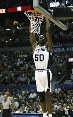 SAN ANTONIO - JUNE 4:  David Robinson #50 of the San Antonio Spurs goes up for a slam dunk in Game one of the 2003 NBA Finals against the New Jersey Nets at SBC Center on June 4, 2003 in San Antonio, Texas.  The Spurs won 101-89.  NOTE TO USER: User expre