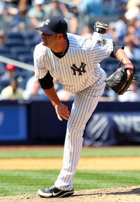 NEW YORK - JULY 06:  Brian Bruney #38 of the New York Yankees pitches against the Toronto Blue Jays on July 6, 2009 at Yankee Stadium in the Bronx borough of New York City.  (Photo by Jim McIsaac/Getty Images)