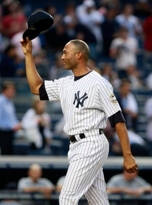 NEW YORK - JUNE 30:  Relief pitcher Mariano Rivera #42 of the New York Yankees waves to the crowd after throwing out the ceremonial first pitch in a game against the Seattle Mariners June 30, 2009 at Yankee Stadium in the Bronx borough of New York City.