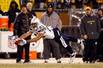 PITTSBURGH - JANUARY 11:  Vincent Jackson #83 of  the San Diego Chargers attempts to make a play on a pass that was originally called a reception but was over turned on a coaches challenge against the Pittsburgh Steelers during their AFC Divisional Playof